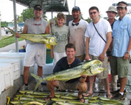 group of people, two holding big fish